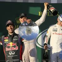 Photo - From left, Red Bull driver Daniel Ricciardo of Australia, Mercedes driver Nico Rosberg of Germany and McLaren driver Kevin Magnussen of Denmark celebrate on the podium after the Australian Formula One Grand Prix at Albert Park in Melbourne, Australia, Sunday, March 16, 2014. Rosberg won the race ahead of Ricciardo and Magnussen. (AP Photo/Rob Griffith)