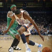 Photo - Oklahoma City's Kevin Durant (35) looses the ball as Boston's Marquis Daniels (8) defens during the NBA game between the Oklahoma City Thunder and the Boston Celtics, Sunday, Nov. 7, 2010, at the Oklahoma City Arena. Photo by Sarah Phipps, The Oklahoman