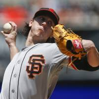 Photo - San Francisco Giants starting pitcher Tim Lincecum throws against the San Diego Padres in the first inning of a baseball game Sunday, July 6, 2014, in San Diego.  (AP Photo/Lenny Ignelzi)