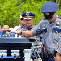 Calls for respect, unity made during funeral for slain police officer