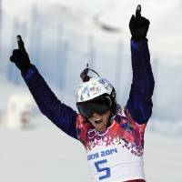Photo - Czech Republic's Eva Samkova reacts after her seeding run during women's snowboard cross competition at the Rosa Khutor Extreme Park, at the 2014 Winter Olympics, Sunday, Feb. 16, 2014, in Krasnaya Polyana, Russia. (AP Photo/Andy Wong)
