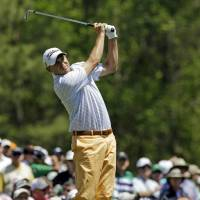 Photo - Bill Haas tees off on the 12th hole during the first round of the Masters golf tournament Thursday, April 10, 2014, in Augusta, Ga. (AP Photo/David J. Phillip)