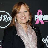 Photo - FILE - This Oct. 2, 2012 file photo originally released by Hard Rock shows TV personality Caroline Manzo at the 13th Annual Pinktober Breast Cancer Awareness Campaign at Hard Rock Cafe in New York. Manzo's latest book,