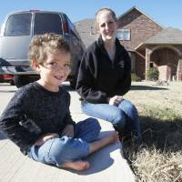 Photo - Ashley Warden was ticketed Sunday by police after her 3-year-old son, Dillan, tried to urinate in their front yard in Piedmont. Piedmont Police Chief Alex Oblein says writing the ticket was a mistake. Photo by Paul Hellstern, The Oklahoman