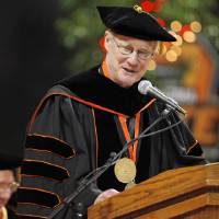Photo - GRADUATION: Burns Hargis, OSU president, speaks during the 12:30 p.m. undergraduate commencement ceremony inside of Gallagher-Iba Arena at Oklahoma State University in Stillwater, Okla., Saturday, May 7, 2011. This was the second of three undergraduate commencement ceremonies at OSU on Saturday. Photo by Nate Billings, The Oklahoman ORG XMIT: KOD