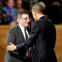 Photo - President Barack Obama embraces outgoing Defense Secretary Leon Panetta during an Armed Forces Farewell Ceremony to honor Panetta, Friday, Feb. 8, 2013, at Joint Base Myer-Henderson Hall in Arlington, Va. (AP Photo/Ann Heisenfelt)