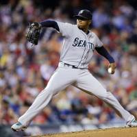 Photo - Seattle Mariners starting pitcher Roenis Elias throws a pitch in the fourth inning of an interleague baseball game against the Philadelphia Phillies on Monday, Aug. 18, 2014, in Philadelphia. (AP Photo/Michael Perez)