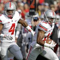 Photo - Ohio State cornerback Doran Grant heads to the end zone in front of teammate C.J. Barnett after making an interception against Purdue during the first half of an NCAA college football game in West Lafayette, Ind., Saturday, Nov. 2, 2013. (AP Photo/Michael Conroy)