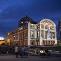 Photo - This May 20, 2014 photo, the Teatro Amazonas is seen as dusk in Manaus, Brazil. The theater is the symbol of Manaus, a city carved out of the rainforest, still so remote it can only be reached by plane or boat even though it has grown to over 2 million inhabitants. (AP Photo/Felipe Dana)
