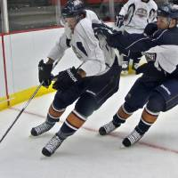 Photo - AHL HOCKEY: The Barons' Cameron Abney, left, and Dan Ringwald battle for the puck in front of the net during the opening day of training camp for the Oklahoma City Barons at the Cox Convention Center on Monday, Sept. 26, 2011, in Oklahoma City, Okla. Photo by Chris Landsberger, The Oklahoman  ORG XMIT: KOD