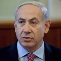 Photo -   Israel's Prime Minister Benjamin Netanyahu heads the weekly cabinet meeting at his office in Jerusalem, Sunday, July 8, 2012. (AP Photo/Uriel Sinai, Pool)