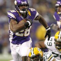 Photo - Minnesota Vikings running back Adrian Peterson (28) runs from Green Bay Packers inside linebacker Brad Jones (59) during the first half of an NFL football game Sunday, Dec. 30, 2012, in Minneapolis. (AP Photo/Genevieve Ross)