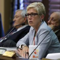 Photo -  Janet Barresi, state schools superintendent, speaks Wednesday during an Oklahoma state Board of Education meeting in Oklahoma City. The board voted 5-1 to again delay adopting a formal plan to replace Common Core standards. AP photo    -  AP