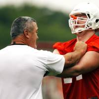 Photo - OKLAHOMA STATE UNIVERSITY / OSU COLLEGE FOOTBALL: Oklahoma State offensive line coach Joe Wickline gives instruction to lineman Parker Graham (right) during practice on August 2, 2013. Wickline is entering his 9th season at Oklahoma State. Photo by KT KING, The Oklahoman