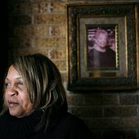 Photo - Jacqueline Parks, executive director at Metropolitan Better Living Center, poses under a picture of her mother Juanita Davis on Wednesday, Nov. 18, 2009. Juanita Davis started the Metropolitan Better Living Center.  By John Clanton, The Oklahoman