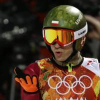 Photo - Poland's Kamil Stoch blows a kiss after his first attempt during the men's normal hill ski jumping final at the 2014 Winter Olympics, Sunday, Feb. 9, 2014, in Krasnaya Polyana, Russia. (AP Photo/Gregorio Borgia)