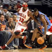 Photo -   Chicago Bulls guard Richard Hamilton (32) battles Oklahoma City Thunder guard James Harden for the ball during the first half of an NBA preseason basketball game, Tuesday, Oct. 23, 2012, in Chicago. (AP Photo/Charles Rex Arbogast)