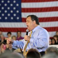 Photo - FILE - New Jersey Gov. Chris Christie answers a question in this April 30, 2013 file photo taken in Long Beach Township, N.J., during a town hall meeting. Christie secretly underwent gastric band surgery in February to try to lose weight at the urging of his family. Christie told The New York Post for a story in Tuesday's May 7, 2013 edition. (AP Photo/Mel Evans, File)
