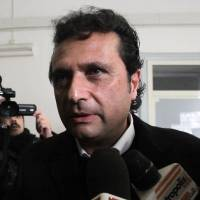 Photo - FILE -- In this photo from files taken in Naples on Jan. 30, 2013, Captian Francesco Schettino speaks to the media. The Italian captain of the Costa Concordia cruise ship was ordered on Wednesday to stand trial for manslaughter in the luxury liner's shipwreck off the coast of Tuscany, which killed 32 people. Judge Pietro Molino, at a closed door hearing in the town of Grosseto, agreed to prosecutors' requests that Francesco Schettino should be tried on charges of manslaughter, causing the shipwreck and abandoning the vessel while many of the 4,200 passengers and crew were still aboard. (AP Photo/Salvatore Laporta)
