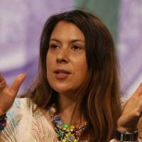 Photo - 2013 Wimbledon champion Marion Bartoli of France attends a press conference at the All England Lawn Tennis Championships in Wimbledon, London,  Sunday June 22, 2014.  The Championships start Monday June 23. (AP Photo/AELTC, Scott Heavey)