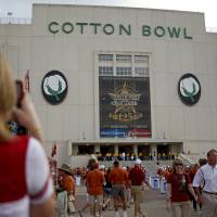 Photo - Fans walk outside the Cotton Bowl before the Red River Rivalry college football game between the University of Oklahoma Sooners (OU) and the University of Texas Longhorns (UT) at the Cotton Bowl in Dallas, Saturday, Oct. 8, 2011. Photo by Bryan Terry, The Oklahoman  ORG XMIT: KOD