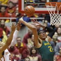 Photo - Baylor center Isaiah Austin, right, fights for a rebound with Iowa State guard Naz Long during the first half of an NCAA college basketball game, Tuesday, Jan. 7, 2014, in Ames, Iowa. (AP Photo/Charlie Neibergall)