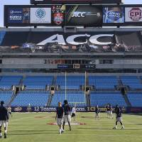 Photo - Georgia Tech walk on the field during a walk through of the stadium on on Friday, Nov. 30, 2012, in advance for Saturday's ACC Championship NCAA college football game against Florida State. (AP Photo/The Charlotte Observer,  John D. Simmons) LOCAL TV OUT (WSOC, WBTV, WCNC, WCCB); LOCAL PRINT OUT (CHARLOTTE BUSINESS JOURNAL, CREATIVE LOAFLING, CHARLOTTE WEEKLY, MECHLENBURG TIMES, CHARLOTTE MAGAZINE, CHARLOTTE PARENTS) LOCAL RADIO OUT (WBT)  ORG XMIT: NCCHN203