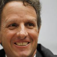 Photo - FILE - In this Wednesday, Sept. 22, 2010, file photo, Secretary of the Treasury, Timothy Geithner testifies before the House Financial Services Committee, about the state of the international Financial system, including international regulatory issues relevant to the implementation of the Dodd-Frank Act, on Capitol Hill in Washington. Geithner said the massive bill would accomplish its primary objective of building more safeguards against the kind of financial collapse that had cost millions of jobs and sent the country into the worst recession since the Great Depression. (AP Photo/Alex Brandon, File)