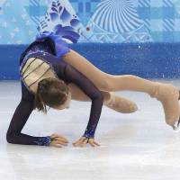 Photo - Julia Lipnitskaya of Russia falls as she competes in the women's short program figure skating competition at the Iceberg Skating Palace during the 2014 Winter Olympics, Wednesday, Feb. 19, 2014, in Sochi, Russia. (AP Photo/Darron Cummings)