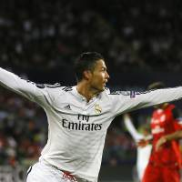Photo - Real Madrid's Cristiano Ronaldo celebrates after scoring the second goal during the UEFA Super Cup soccer match between Read Madrid and Sevilla at Cardiff City Stadium in Wales Tuesday, Aug. 12, 2014. (AP Photo/Kirsty Wigglesworth)
