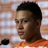 Photo - Memphis Depay of the Netherlands listens during a press conference held after a training session in Rio de Janeiro, Brazil, Tuesday, June 24, 2014. Netherlands will play Group A runner-up Mexico in the second round on Sunday in Fortaleza. (AP Photo/Wong Maye-E)