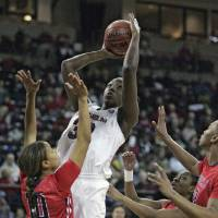 Photo - South Carolina's Elem Ibiam (33) drives for the basket as Ole Miss's Diara Moore (10) tries to block during the first half of an NCAA college basketball game Thursday, Jan. 30, 2014, in Columbia, S.C. (AP Photo/Mary Ann Chastain)