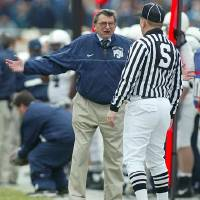 Photo - Penn State coach Joe Paterno, left, makes a point with side judge John Roggeman during the first quarter of Penn State's 41-10 loss to Michigan State, Saturday, Nov. 22, 2003, in East Lansing, Mich. (AP Photo/Al Goldis)
