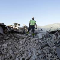 Italians grieve as they honor, bury victims of earthquake