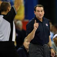Photo -  USA coach Mike Krzyzewski, right, talks with an official during the men's basketball game against China at the Beijing 2008 Olympics in Beijing, Sunday, Aug. 10, 2008.  USA won 101-70. (AP Photo/Dusan Vranic) ORG XMIT: OLY1259