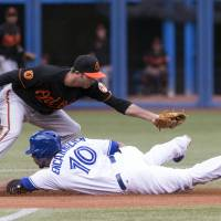 Photo - Toronto Blue Jays' Edwin Encarnacion, right, steals second base in front of Baltimore Orioles' J.J Hardy after a fielders error during the first inning of abaseball game in Toronto on Friday, June 21, 2013. (AP Photo/The Canadian Press, Chris Young)