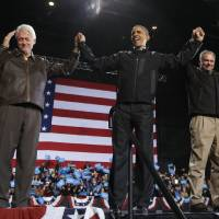 Photo -   In the final hours of a four-state campaign day, President Barack Obama is joined by former President Bill Clinton, left, and Democratic candidate for the U.S. Senate from Virginia, former Gov. Tim Kaine, right, at a rally at Jiffy Lube Live arena, late Saturday night, Nov. 3, 2012, in Bristow, Va. (AP Photo/Pablo Martinez Monsivais)
