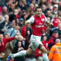 Photo -   FILE - Arsenal's Robin van Persie reacts against Norwich City, during their English Premier League soccer match at Emirates stadium in London, in this Saturday, May 5 file photo, 2012. Manchester United says Wednesday Aug 15 2012 the club has reached an agreement with Premier League rival Arsenal to buy Netherlands striker Robin van Persie.United says Van Persie is yet to agree to personal terms, with the deal subject to a medical examination. No financial details were disclosed, although British media has reported that Arsenal wanted 20 million pounds ($31.3 million) for its captain, who has one year left on his contract. (AP Photo/Bogdan Maran, File)