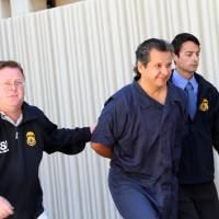 Photo -   Marco Antonio Delgado is escorted out of the El Paso County Jail, Monday, Nov. 5, 2012 in El Paso, Texas. Delgado was arrested by Immigration and Customs Enforcement on charges of conspiracy to commit money laundering according to jail records. (AP Photo/Juan Carlos Llorca)