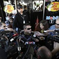 Photo - Driver Tony Stewart is swarmed by the media as he answers questions for after practice Sunday's NASCAR Sprint Cup auto race at Martinsville Speedway in Martinsville, Va., Friday, April 5, 2013.  (AP Photo/Steve Helber)