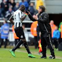 Photo - Newcastle United's Papiss Cisse, left, celebrates his goal with Head Coach John Carver, right, during their English Premier League soccer match against Crystal Palace at St James' Park, Newcastle, England, Saturday, March 22, 2014. (AP Photo/Scott Heppell)