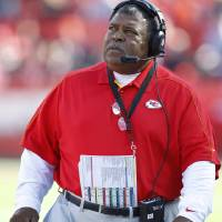 Photo - Kansas City Chiefs coach Romeo Crennel looks at the clock during the first half of an NFL football game against the Denver Broncos at Arrowhead Stadium in Kansas City, Mo., Sunday, Nov. 25, 2012. (AP Photo/Ed Zurga)