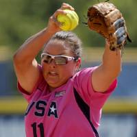 Photo - USA's Jackie Traina pitches during a World Cup of Softball game between USA and the Netherlands at ASA Hall of Fame Stadium in Oklahoma City, Saturday, June 30, 2012. Photo by Bryan Terry, The Oklahoman
