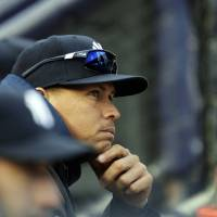 Photo -   New York Yankees' Alex Rodriguez watches from the dugout during the first inning of Game 5 of the American League division baseball series against the Baltimore Orioles, Friday, Oct. 12, 2012, in New York. (AP Photo/Kathy Willens)
