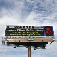 Photo - JAMES MCCANDLESS / INTERSTATE 44: An electronic billboard flashes a wanted ad for James Elton McCandless on I-44 between Pennsylvania Avenue and May Avenue in Oklahoma City Monday, July 20, 2009.  Photo by Ashley McKee, The Oklahoman   ORG XMIT: KOD