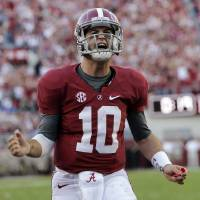 Photo -   Alabama quarterback AJ McCarron (10) reacts after an Alabama score during the first half of an NCAA college football game against Texas A&M at Bryant-Denny Stadium in Tuscaloosa, Ala., Saturday, Nov. 10, 2012. (AP Photo/Dave Martin)