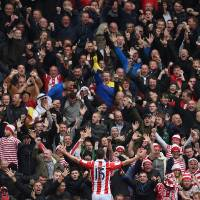 Photo - Stoke City's Charlie Adam celebrates his goal during their English Premier League match at The Hawthorns, West Bromwich, England, Sunday, May 11, 2014. (AP Photo/Joe Giddens, PA Wire)  UNITED KINGDOM    -    NO SALES    -   NO ARCHIVES