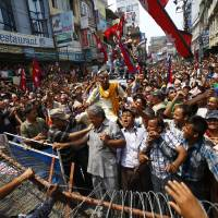 Photo -   Nepal's Brahmins and Chhetri society members hold a demonstration near the Constitution Assembly building in Katmandu, Nepal, Sunday, May 27, 2012. They demanded that states proposed in the new constitution should not be determined on the basis of ethnicity. (AP Photo/Niranjan Shrestha)