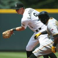 Photo - Colorado Rockies second baseman DJ LeMahieu, back, fields throw as Pittsburgh Pirates' Josh Harrison pulls into second base with a double in the first inning of a baseball game in Denver on Sunday, July 27, 2014. (AP Photo/David Zalubowski)