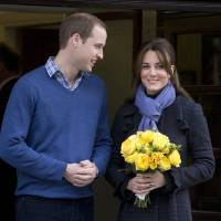 Photo - Britain's Prince William stand next to his wife Kate, Duchess of Cambridge as she leaves the King Edward VII hospital in central London, Thursday, Dec. 6, 2012. Prince William and his wife Kate are expecting their first child, and the Duchess of Cambridge was admitted to hospital suffering from a severe form of morning sickness in the early stages of her pregnancy.  (AP Photo/Alastair Grant)